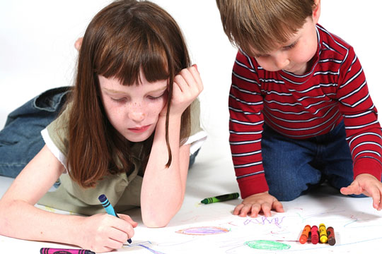 Kids Coloring With Crayons